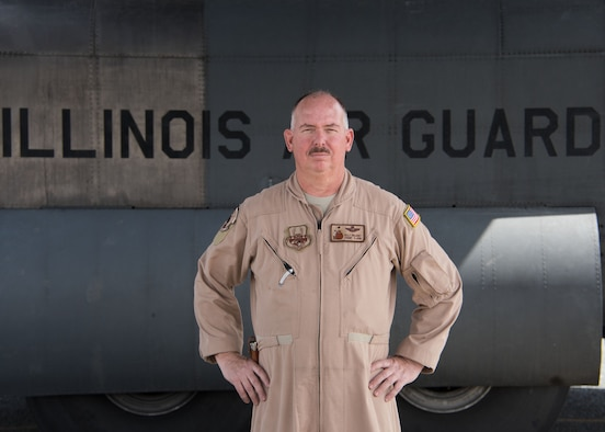 Chief Master Sgt. Kelly Delaney, a 737th Expeditionary Airlift Squadron loadmaster, poses for a photo in front of a C-130H Hercules at an undisclosed location in Southwest Asia, March 3, 2017. Delaney is deployed from the Illinois Air National Guard. (U.S. Air Force photo/Senior Airman Andrew Park)