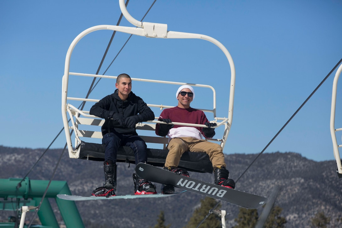 Pfc. Dante Garza and Lance Cpl. Omar Irizarry, riflemen, 2nd Battalion, 7th Marine Regiment, ride a ski lift during a trip to Bear Mountain Ski Resort in Big Bear Lake, Feb. 23, 2017. The trip was provided to the unit courtesy of Operation Adrenaline Rush, a program aimed toward reintegrating Marines and sailors who have just come home from deployment. (U.S Marine photo by Cpl. Medina Ayala-Lo)
