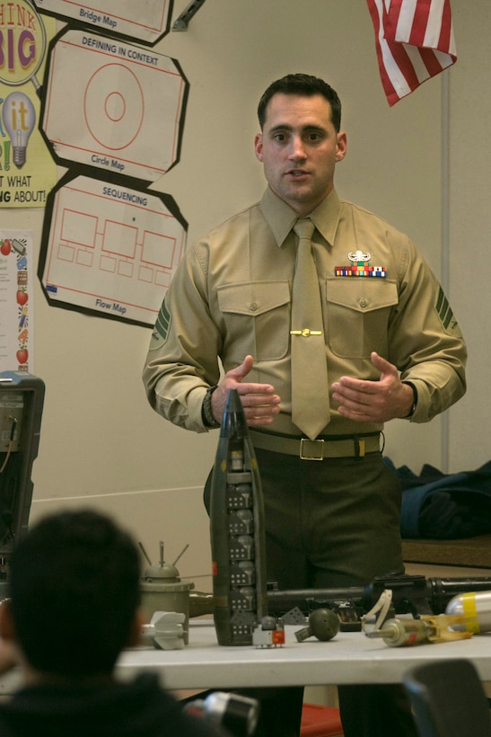 Sgt. Alexander Strait, explosive ordnance diposal technician, talks to Painted Hills Middle School students during a career day in Desert Hot Springs, Calif., Feb. 23, 2017. The purpose of the visit was to further the installations commitment to the community and help inspire children to begin thinking about their future. (Official Marine Corps Photo by Cpl. Julio McGraw/Released)
