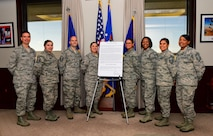 U.S. Air Force Brig. Gen. Paul W. Tibbets IV, the 509th Bomb Wing (BW) commander, far left, and Chief Master Sgt. Melvina Smith, the 509th BW command chief, far right, stand with members of the Women's History Month committee following the signing of the Women's History Month proclamation at Whiteman Air Force Base, Mo., March 1, 2017. During the month of March, all citizens have the opportunity to recognize and commemorate the heritage and contributions that women have bestowed upon history through various events on the installation. (U.S. Force photo by Airman 1st Class Jazmin Smith)