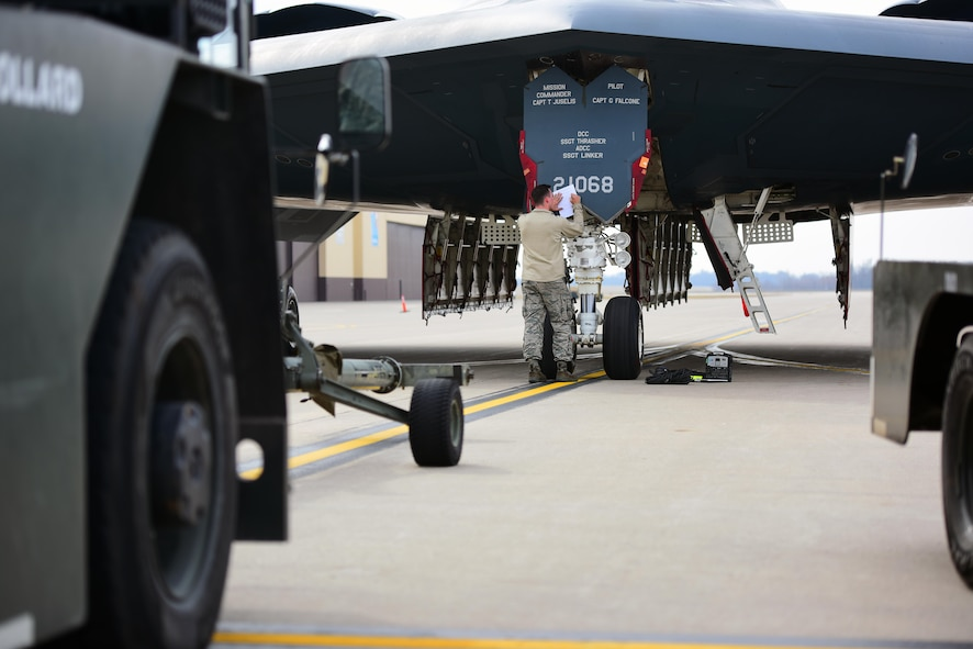 U.S. Air Force Senior Airman Jacob Henry, a crew chief assigned to the 131st Aircraft Maintenance Squadron, completes a checklist during a no-notice operational readiness exercise at Whiteman Air Force Base, Mo., Feb. 28, 2017. During the exercise, Airmen were tasked with executing procedures and operations to validate Whiteman's strategic deterrence and operational readiness. (U.S. Air Force photo by Airman 1st Class Jazmin Smith)