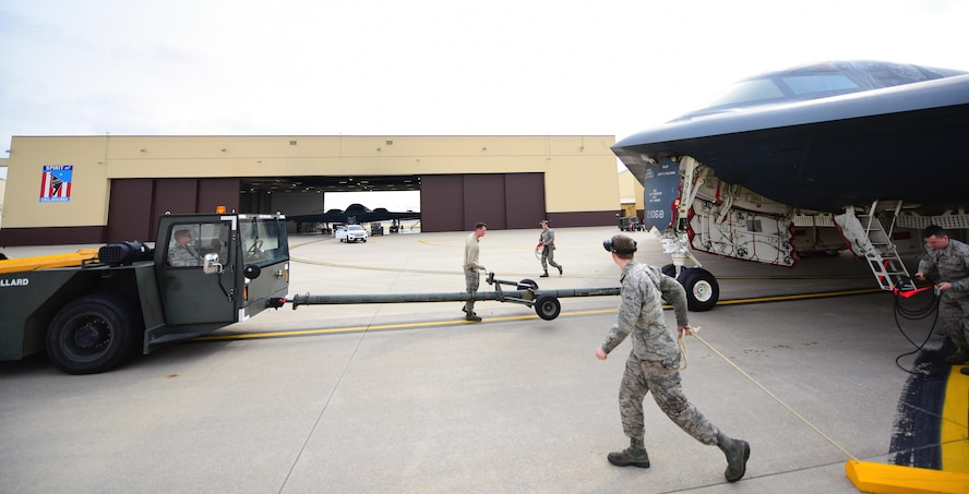 Crew chiefs assigned to the 509th and 131st Aircraft Maintenance Squadrons prepare to tow a B-2 Spirit into its dock during a no-notice operational readiness exercise at Whiteman Air Force Base, Mo., Feb. 28, 2017. During the exercise, Airmen were tasked with executing procedures and operations to validate Whiteman's strategic deterrence and operational readiness.