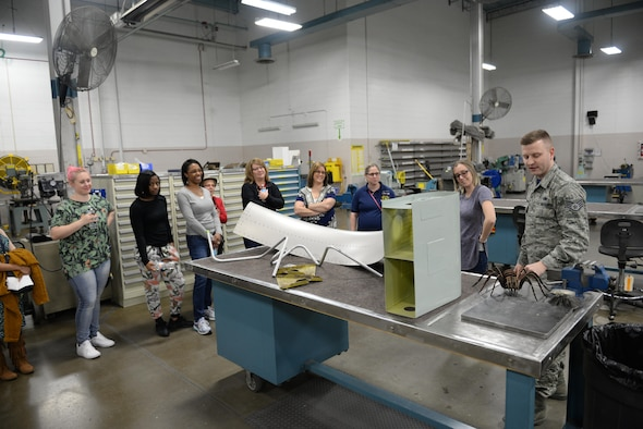 Staff Sgt. Konrad Jazwierski, 55th Maintenance Squadron aircraft structural maintenance technician, shows 55th MXS spouses the sheet metal shop in the Bennie L. Davis Maintenance Facility at Offutt Air Force Base, Neb., Feb. 17, 2017. Members of the 55th MXS had a chance to show their spouses what they do for the Air Force.(U.S. Air Force photo by Zachary Hada)