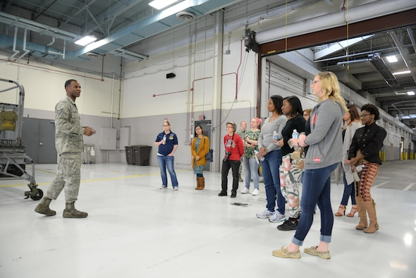 Staff Sgt. Andrew Scipio, 55th Maintenance Squadron aerospace ground equipment craftsman, gives a tour of the AGE shop to 55th MXS spouses in the Bennie L. Davis Maintenance Facility at Offutt Air Force Base, Neb., Feb. 17, 2017. Members of the 55th MXS had a chance to show their spouses what they do for the Air Force.(U.S. Air Force photo by Zachary Hada)