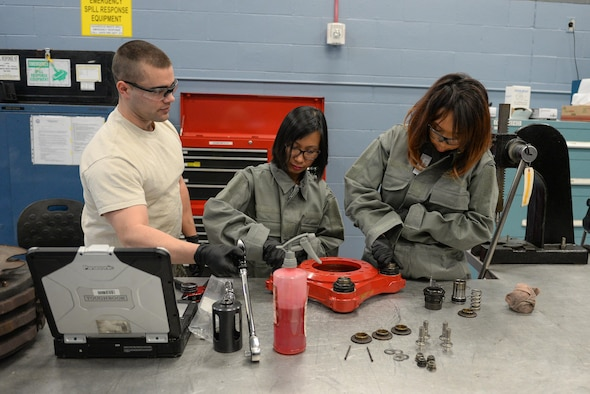 Airman 1st Class Kameron Hamilton, 55th Maintenance Squadron hydraulics system journeyman, shows 55th MXS spouses how to work on an RC-135 break assembly part in the Bennie L. Davis Maintenance Facility at Offutt Air Force Base, Neb., Feb. 17, 2017. The tour began with a briefing followed by a tour of all the shops in the maintenance facility and ended with an aircraft tour. (U.S. Air Force photo by Zachary Hada)
