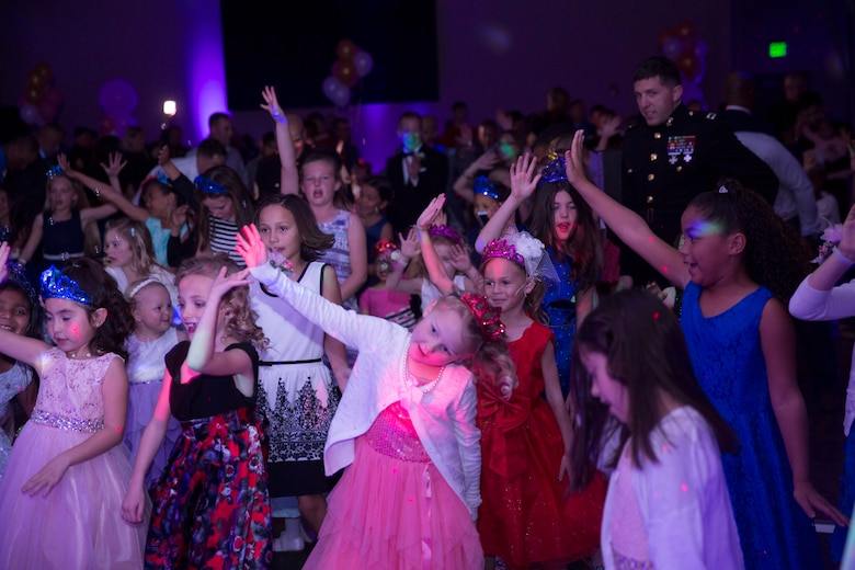 Marines' and sailors' daughters enjoy themselves on the dance floor of the reception hall during the annual Father Daughter Dance at building 1707 aboard Marine Corps Air Ground Combat Center, Twentynine Palms, Calif., Feb. 25, 2017. Marine Corps Community Services hosted the event to provide an opportunity for Marines and sailors to spend time with their daughters. (U.S. Marine Corps photo by Cpl. Medina Ayala-Lo)
