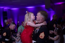 Staff Sgt. Robert A. Bouchard, EOD Technician, holds his daughter, Tenley, 3, as they dance during the annual Father Daughter Dance at building 1707 aboard Marine Corps Air Ground Combat Center, Twentynine Palms, Calif., Feb. 25, 2017. Marine Corps Community Services hosted the event to provide an opportunity for Marines and sailors to spend time with their daughters. (U.S. Marine Corps photo by Cpl. Medina Ayala-Lo)