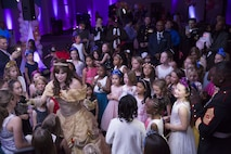 """Marines' and sailors' daughters sing """"Let it Go"""" with Princess Belle during the annual Father Daughter Dance at building 1707 aboard Marine Corps Air Ground Combat Center, Twentynine Palms, Calif., Feb. 25, 2017. Marine Corps Community Services hosted the event to provide an opportunity for Marines and sailors to spend time with their daughters. (U.S. Marine Corps photo by Cpl. Medina Ayala-Lo)"""