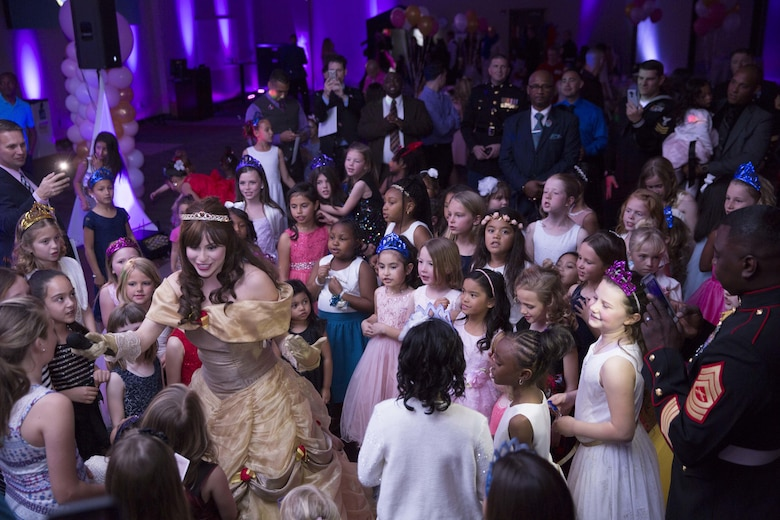 "Marines' and sailors' daughters sing ""Let it Go"" with Princess Belle during the annual Father Daughter Dance at building 1707 aboard Marine Corps Air Ground Combat Center, Twentynine Palms, Calif., Feb. 25, 2017. Marine Corps Community Services hosted the event to provide an opportunity for Marines and sailors to spend time with their daughters. (U.S. Marine Corps photo by Cpl. Medina Ayala-Lo)"