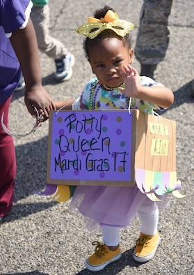 Autumn Whidby, daughter of Tech. Sgt. Albert Whidby, 334th Training Squadron instructor supervisor, participates in the Keesler Child Development Center Mardi Gras parade Feb. 28, 2017, on Keesler Air Force Base, Miss. More than 300 children participated in the event, which started in 2009. (U.S. Air Force photo by Kemberly Groue)