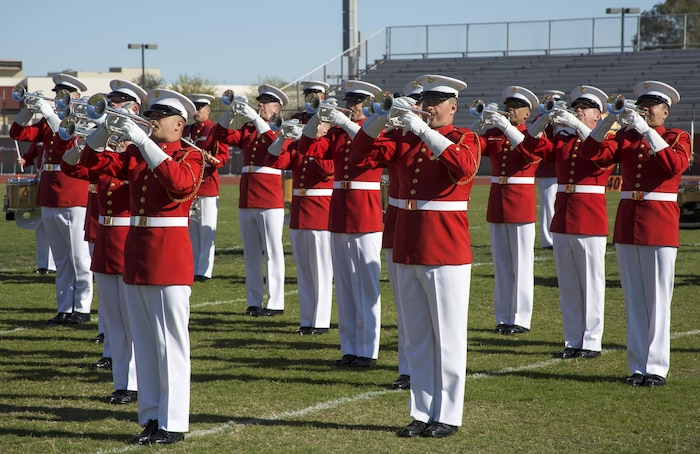 "Marines with the U.S. Marine Drum & Bugle Corps execute music in motion during their first performance as a part of the U.S. Marine Corps Battle Color Detachment (BCD) performance tour at Kofa High School, Yuma, Az., Mar. 1, 2017. The BCD is comprised of the Marine Corps Silent Drill Platoon, ""The Commandant's Own,"" the United States Marine Drum & Bugle Corps and the Marine Corps Color Guard. The Marines of this highly skilled unit travel across the country to demonstrate the discipline, professionalism, and ""Esprit de Corps"" of United States Marines. (Official Marine Corps photo by Cpl. Robert Knapp/Released)"