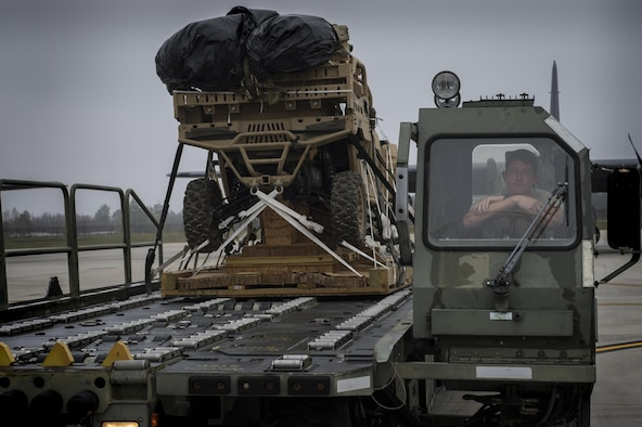 An Airman waits to load a military RZR all-terrain vehicle onto an HC-130J Combat King II, before a vehicle drop exercise, March 1, 2017, at Moody Air Force Base, Ga.  This was the first time the 38th Rescue Squadron dropped a MRZR and a significant feat as it landed on target, with no damage or discrepancies. (U.S. Air Force photo by Tech. Sgt. Zachary Wolf)