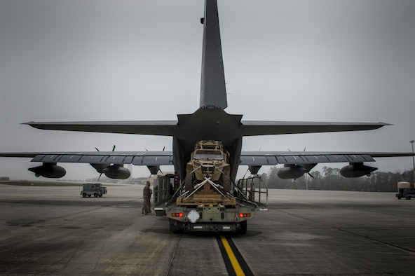 Airmen load a military RZR all-terrain vehicle into an HC-130J Combat King II, before a vehicle drop exercise, March 1, 2017, at Moody Air Force Base, Ga.  This was the first time the 38th Rescue Squadron dropped a MRZR and a significant feat as it landed on target, with no damage or discrepancies. (U.S. Air Force photo by Tech. Sgt. Zachary Wolf)