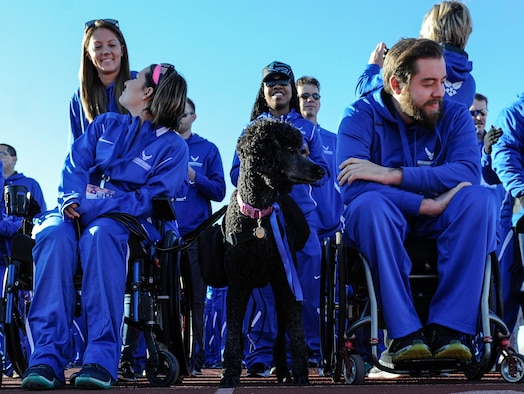 Competitors wait to be announced before the 2017 Air Force Wounded Warrior Trials opening ceremony on Nellis Air Force Base, Nev., Feb. 24, 2017. The Trials are an adaptive sports event designed to promote the mental and physical well-being of seriously ill and injured military members and veterans. (U.S. Air Force photo by Airman 1st Class Kevin Tanenbaum/Released)