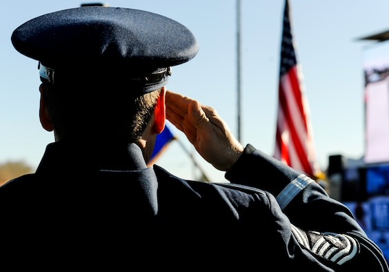 A member of the Air Force Band salutes the American Flag during the playing of the national anthem at the 2017 Air Force Wounded Warrior Trials opening ceremony on Nellis Air Force Base, Nev., Feb. 24, 2017.The Air Force Wounded Warrior Program is a Congressionally-mandated and federally-funded program that provides personalized care, services and advocacy to wounded, ill or injured recovering service members. (U.S. Air Force photo by Airman 1st Class Kevin Tanenbaum/Released)