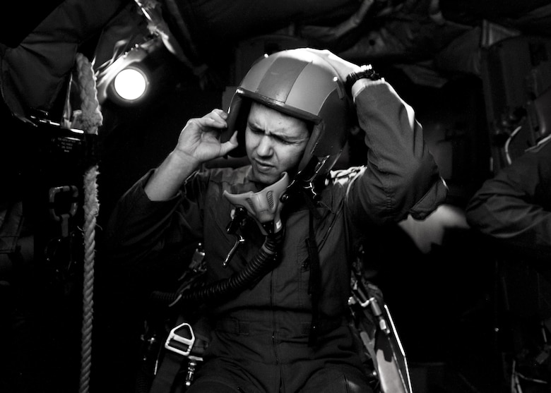 A 23rd Bomb Squadron aircrew member adjusts his helmet during egress training at Minot Air Force Base, N.D., Feb. 22, 2017. Aircrew trained in a simulated aircraft, where they learned how and when to safely exit the aircraft in the event of an emergency. (U.S. Air Force photo/Senior Airman J.T. Armstrong)