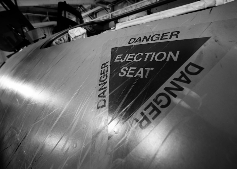 An ejection seat safety emblem decorates the side of an egress training simulator at Minot Air Force Base, N.D., Feb. 22, 2017. The egress simulator was constructed from the nose of a B-52G, similar to the B-52 Stratofortress. (U.S. Air Force photo/Senior Airman J.T. Armstrong)