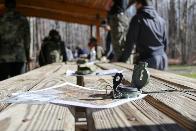 A protractor, a map, and a lensatic compass sit ready to be used by future Marines known as poolees of Marine Corps Recruiting Substation Mentor, Ohio, during a poolee function where the Marine recruiters taught a class on land navigation, February 18. The class gave the poolees an opportunity to practice a vital military skill.  The poolees had to locate five points in Hogback Ridge Park by applying the basic techniques and rules of land navigation. (U.S. Marine Corps photo by Sgt. Stephen D. Himes/Released)