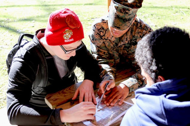 U.S. Marine Private Hector Picasso helps mentor future Marines known as poolees during a land navigation class at Hogback Ridge Park in Mentor, Ohio, February 18. Picasso is home on permissive recruiters' assistance at Marine Corps Recruiting Substation Mentor. Land navigation is a crucial skill Marines need to know so they can find their way in the unfamiliar locations. Poolees will have to perform both day and night land navigation during recruit training and a successful completion of both training events is required to graduate. Picasso is from Ashtabula, Ohio, and graduated from Lakeside High School.(U.S. Marine Corps photo by Sgt. Stephen D. Himes/Released)