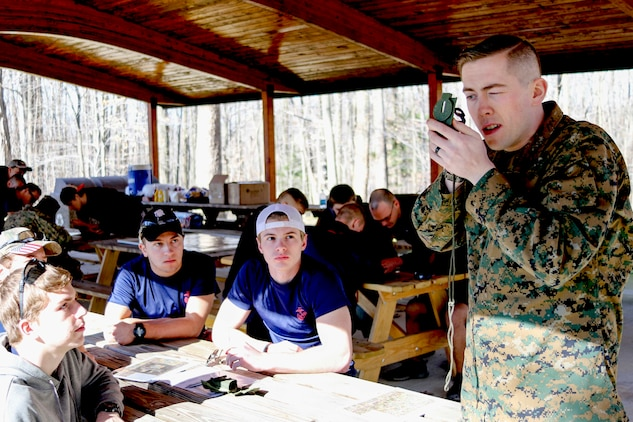 U.S. Marine Staff Sergeant Kevin Osborne performs a thumb-loop hold with a compass for a group of future Marines known as poolees from Marine Corps Recruiting Substation Mentor, Ohio, February 18 at Hogback Ridge Park. The poolees were taught how to conduct land navigation and then they put their skills to the test during a practical application period where they plotted points, determined an the azimuth, and located various points around the park. These poolees will be shipping to Marine Corps Recruit Training within the next 365 days.  (U.S. Marine Corps photo by Sgt. Stephen D. Himes/Released)