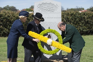 (Left to right) U.S. Air Force Brig. Gen. Heather Pringle, 502nd Air Base Wing and Joint Base San Antonio commander, retired Army Col. Stewart Wyland and retired U.S. Air Force Col. James Humphries lay a wreath at a memorial honoring Army Lt. Benjamin Foulois' first military flight March 2, 2017. In 1910, Foulois became the first person to make a military flight, from a military facility, in a government owned plane flown by a military-trained pilot.(U.S. Air Force photo by Senior Airman Stormy Archer)