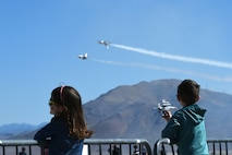 Children of Creech service members watch the U.S. Air Force Thunderbirds perform during 'Family Day,' March 1, 2017, at Creech Air Force Base, Nev. Family Day included demonstrations from the Thunderbirds, USO support, several Airman and Family Readiness Center functions and family-friendly amenities to support the event. (U.S. Air Force photo/Airman 1st Class James Thompson)