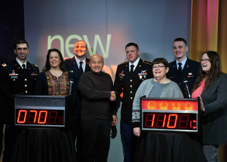 """U.S. Soldiers and U.S. Airmen from Joint Base Lewis-McChord, Wash., pose for a photo with a group of civilians from the King 5 """"New Day"""" show studio audience following a game of head-to-head trivia, Feb. 28, 2017 in Seattle, Wash. Though the competition was close, the team representing JBLM, which featured two Soldiers and two Airmen, emerged victorious. (U.S. Air Force photo/Staff Sgt. Whitney Amstutz)"""