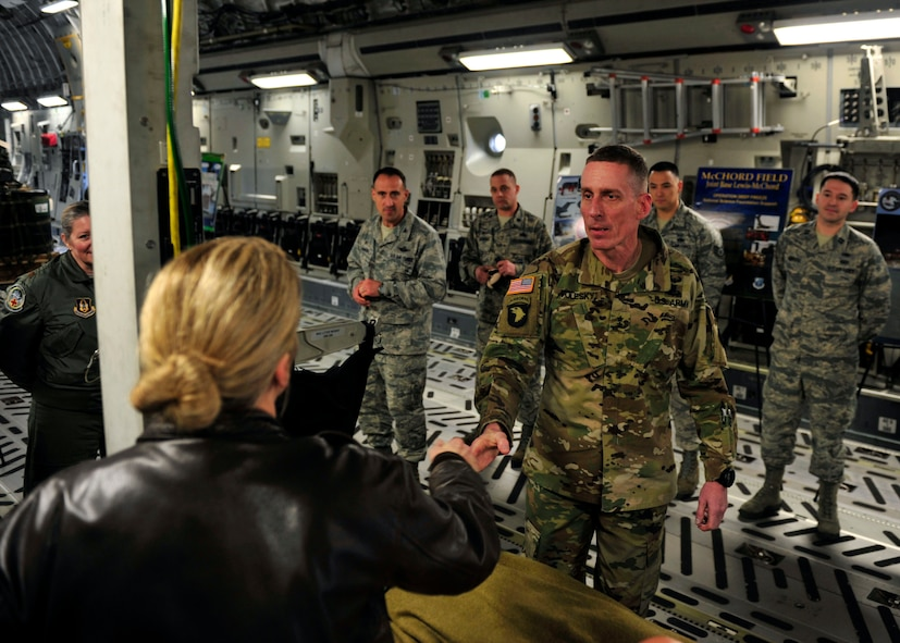U.S. Army Maj. Gen. Gary Volesky, incoming I Corps commanding general, shakes hands with an Airman prior to receiving an interactive C-17 brief during a tour on the McChord Field flightline, March 2, 2017 at Joint Base Lewis-McChord. The tour was designed to better acquaint Volesky with Air Force capabilities and mission sets prior to his transition as the I Corps commanding general. (U.S. Air Force photo/Staff Sgt. Whitney Amstutz)