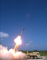A Terminal High Altitude Area Defense interceptor is launched from a THAAD battery on Wake Island a Nov. 1, 2015, operational flight test. During the test, the THAAD system successfully intercepted two air-launched ballistic missile targets. Defense Missile Agency photo by Ben Listerman