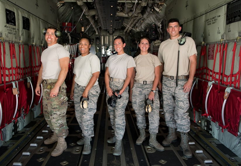 "Participants of 612th Air Base Squadron's ""Crew Chief for a Day"" program pose for a photo in a C-130 Hercules aircraft at Soto Cano Air Base, March 2. The program aims to get other servicemembers from JTF-Bravo to come out to the airfield and experience a day in the life of a U.S. Air Force crew chief."