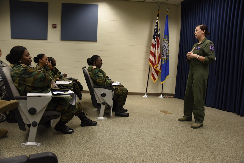 Capt. Shannon Davis, 175th Fighter Squadron pilot, shares her experience in the military with the Suriname female officers March 3, 2017 at Joe Foss Field, S.D. Female Officers of the Suriname Army visited with members of the South Dakota Air National Guard as part of a Women in Leadership Subject Matter Exchange program. (U.S. Air National Guard photo by Staff Sgt. Duane Duimstra/Released)