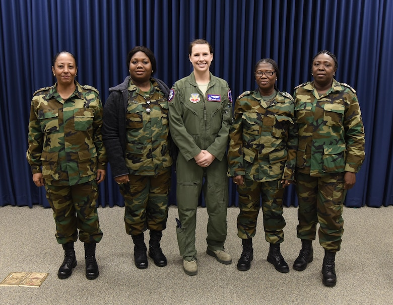 Capt. Eria Wamenie, Head of S4, Army, Capt. Sandra Ponit, Deputy S2, Military Police, Capt. Shannon Davis, 175th Fighter Squadron pilot, Maj. Sieglein Grot, Suriname Army, Head of Suriname Military Family Support, and Capt. Hemma Grebbe, Head of S1, Army, poses for a picture during the Suriname officer visit March 3, 2017 at Joe Foss Field, S.D. Female Officers of the Suriname Army visited with members of the South Dakota Air National Guard as part of a Women in Leadership Subject Matter Exchange program (U.S. Air National Guard photo by Staff Sgt. Duane Duimstra/Released)