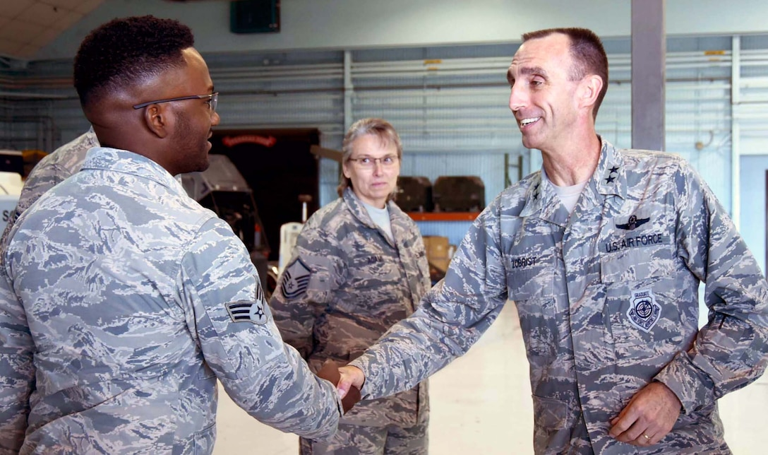 NAVAL AIR STATION FORT WORTH JOINT RESERVE BASE, Texas -- Maj. Gen. Scott Zobrist, 9th Air Force commander, coins Senior Airman Kevin Binion, a maintainer from the 355th Fighter Squadron, here for excellence in the performance of his duties, Mar. 2, 2017. The general visited and spoke with Airmen of the 355 FS, an active associate component of the 301st Fighter Wing, to get feedback about Total Force Integration, job performance and living conditions they experience. The 355 FS functions as a geographically separated unit under the 495th Fighter Group, 9th AF, Shaw Air Force Base, S.C. (U.S. Air Force photo by Tech. Sgt. Melissa Harvey)
