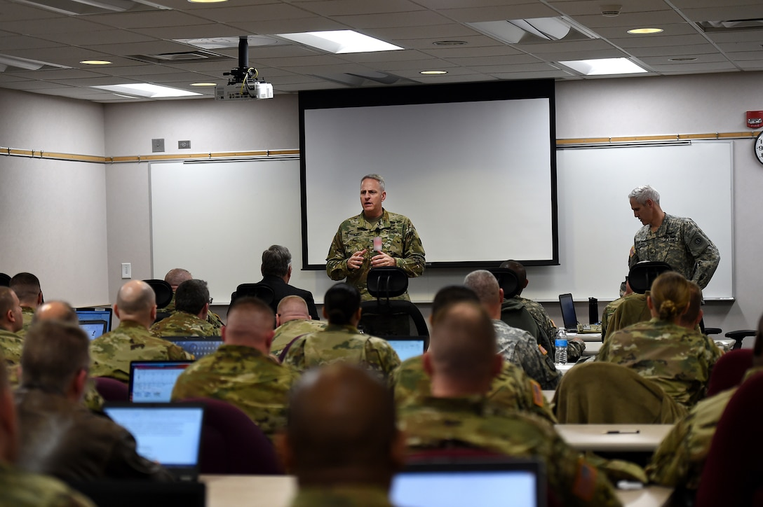 Col. Robert Cooley, Deputy Commander, 85th Support Command, gives opening remarks during an operational mobilization training and assessment brief hosted by the 85th Support Command, at their headquarters outside of Chicago, Mar. 3, 2017.  The briefing was to prepare the 85th Support Command's Army Reserve logistics support and training support battalions, operationally controlled by First Army, that have been identified for upcoming mobilizations in support of First Army's post mobilization training requirements at Mobilization Force Generation Installations. Throughout the three-day assessment brief, the command staffs prepare the units in terms of readiness, training, equipment and personnel. The briefing highlights the Army Reserve's contribution within the multi-component partnership shared with First Army. Army Reserve Soldiers have different mechanisms, and funding allocations to name a few contrasts from their active component partners, but Cooley explained that the end state is the same – to get trained Soldiers ready to do their mission whether it is CONUS (Continental United States) or OCONUS (Outside Continental United States). The goal for the three-day event is to establish a unified, synchronized deployment readiness plan for the execution of pre-deployment training. (U.S. Army photo by Master Sgt. Anthony L. Taylor/Released)