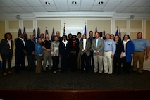 Team Shaw honorary commanders stand for a photo at the Carolina Skies Club and Conference Center at Shaw Air Force Base, S.C., March 3, 2017. Fourteen new honorary commanders were welcomed to the program during a ceremony at the club. (U.S. Air Force photo by Airman 1st Class Kelsey Tucker)