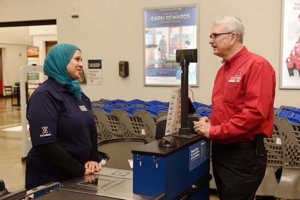Mike Immler, Army and Air Force Exchange Service deputy director, speaks with Fatiha Armstrong, Exchange store associate, during a tour of AAFES facilities, March 1, 2017, Vandenberg Air Force Base, Calif. Immler toured the AAFES facilities to ensure needs of Airmen are met. (U.S. Air Force photo by Tech. Sgt. Jim Araos/Released)