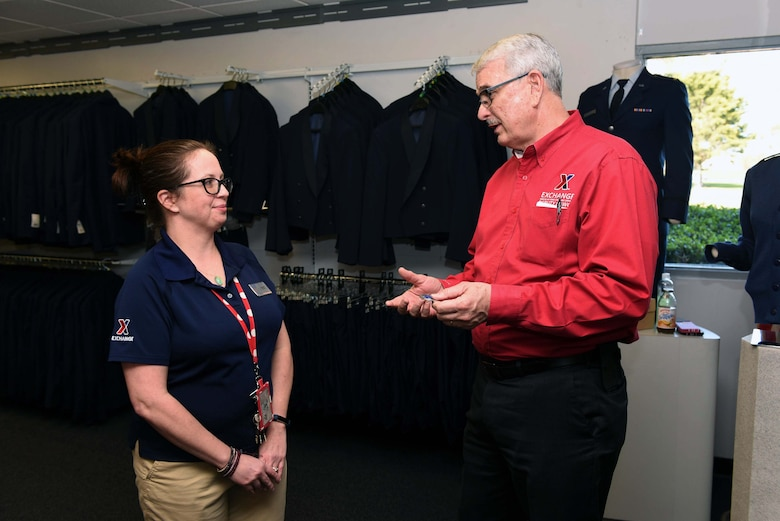 Mike Immler, Army and Air Force Exchange Service deputy director, speaks with Jennifer Hill, Military Clothing Sales shift supervisor, during a tour of AAFES facilities, March 1, 2017, Vandenberg Air Force Base, Calif. Immler toured the AAFES facilities to ensure needs of Airmen are met. (U.S. Air Force photo by Tech. Sgt. Jim Araos/Released)