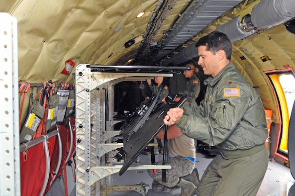 Maj. Phil Schembri, pilot with the 151st Air Refueling Squadron, assists medical personnel from the 375th Aeromedical Evacuation Squadron in reconfiguring a Utah Air Guard KC-135R Stratotanker to carry stretchers during an aeromedical evacuation mission on Feb. 18, 2017. (U.S. Air National Guard photo by Tech. Sgt. Annie Edwards)