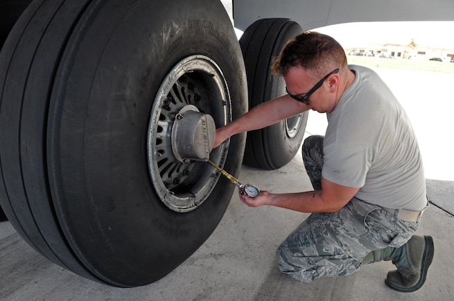Master Sgt. George LaCome, a crew chief with the 151st Maintenance Group checks the tire pressure on a KC-135R Stratotanker during a preflight inspection in Andersen Air Force Base, Guam. The Utah Air Guard aircraft and six-person crew conducted an aeromedical evacuation mission in the Pacific theater Feb. 8-25, 2017.