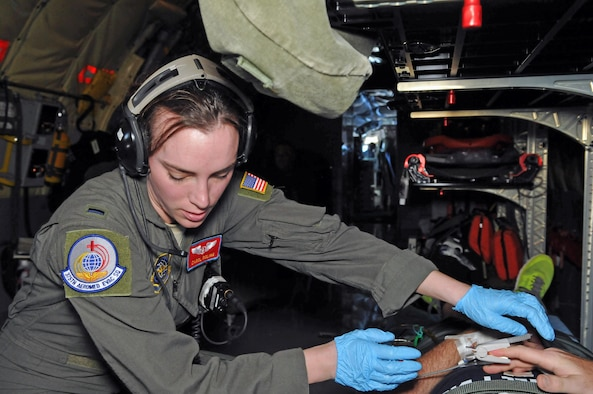 1st Lt. Carol Roling, flight nurse with the 375th Aeromedical Evacuation Squadron from Scott Air Force Base, Ill., checks on a patient during an aeromedical evacuation flight from the Pacific theater to the U.S. on Feb. 21, 2017. A Utah Air Guard KC-135R Stratotanker and six-person crew from the 151st Air Refueling Squadron conducted an AE mission with the active duty medical personnel Feb. 18-25, 2017. (U.S. Air National Guard photo by Tech. Sgt. Annie Edwards)