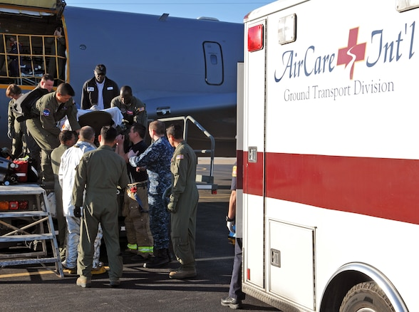 A patient is transferred from a Utah Air National Guard KC-135R Stratotanker to an ambulance after arriving in Naval Air Station North Island in San Diego on Feb. 24, 2017. (U.S. Air National Guard photo by Tech. Sgt. Annie Edwards)