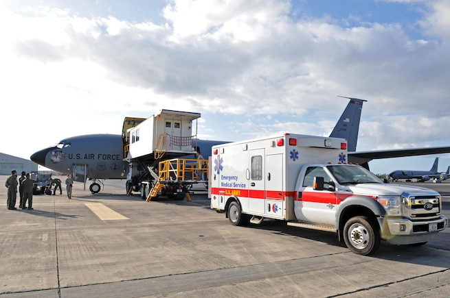 Medical personnel prepare to transfer patients from a KC-135R Stratotanker to an ambulance after arriving on an aeromedical evacuation flight to Hickam Air Force Base, Hawaii on Feb. 23, 2017. (U.S. Air National Guard photo by Tech. Sgt. Annie Edwards)