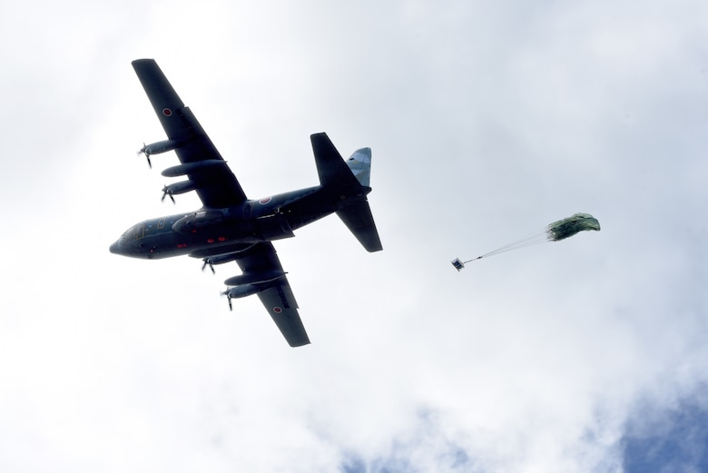 A Japan Air Self-Defense Force C-130 Hercules conducts for an airdrop during Exercise Cope North 17 at North Field, Tinian, Feb. 22, 2017. The exercise includes 22 total flying units and more than 2,700 personnel from three countries and continues the growth of strong, interoperable relationships within the Indo-Asia-Pacific region through integration of airborne and land-based command and control (U.S. Air Force photo by Airman 1st Class Jacob Skovo).