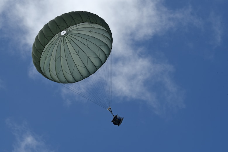 A water barrel falls after being airdropped by a Japan Air Self-Defense Force C-130 Hercules during Exercise Cope North 17 at North Field, Tinian, Feb. 22, 2017. The exercise includes 22 total flying units and more than 2,700 personnel from three countries and continues the growth of strong, interoperable relationships within the Indo-Asia-Pacific region through integration of airborne and land-based command and control (U.S. Air Force photo by Airman 1st Class Jacob Skovo).