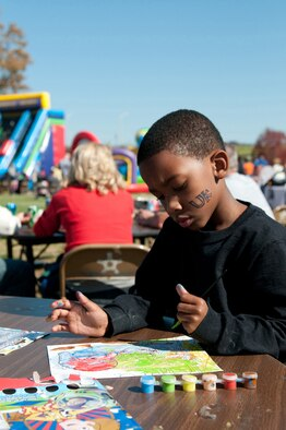 Adarius Hite, son of Kentucky Air National Guard member 2nd Lt. Angela Hite, paints pictures during Family Day at the 123rd Airlift Wing in Louisville, Ky., Oct. 21, 2012. One of the reasons the Airman and Family Readiness Program is being recognized is because of the multiple family activities it sponsors on base.  (Kentucky Air National Guard photo by Senior Airman Vicky Spesard)