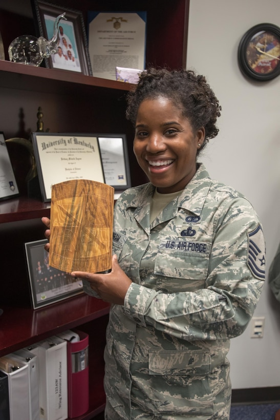 Master Sgt. Brittany Ingram, an Airman from the 123rd Airlift Wing Louisville, Kentucky, shows the plaque given to her by the group of U.S. Army Reserve Officer Corps cadets that she accompanied to Djibouti, Africa over the summer as a cadre member for the U.S. Army Command's Cultural Language and Proficiency program. (U.S. Air National Guard photo by Tech. Sgt. Vicky Spesard)