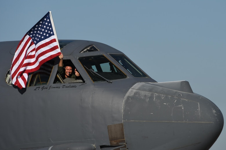 U.S. Air Force Lt. Col. Brent Weisner, 93rd Bomb Squadron commander waves the U.S. flag and gives a thumbs prior to takeoff at Barksdale Air Force Base, La., March 3, 2017.   The gestures by Weisner signified the historic nature of the flight which gave Lt. Col. Steve Smith, 93rd BS flight instructor, more than 10,000 flight hours in the B-52 Stratofortress. Smith has more hours in the B-52 than any other current member of the Air Force. (U.S. Air Force photo by Tech. Sgt. Ted Daigle/Released)