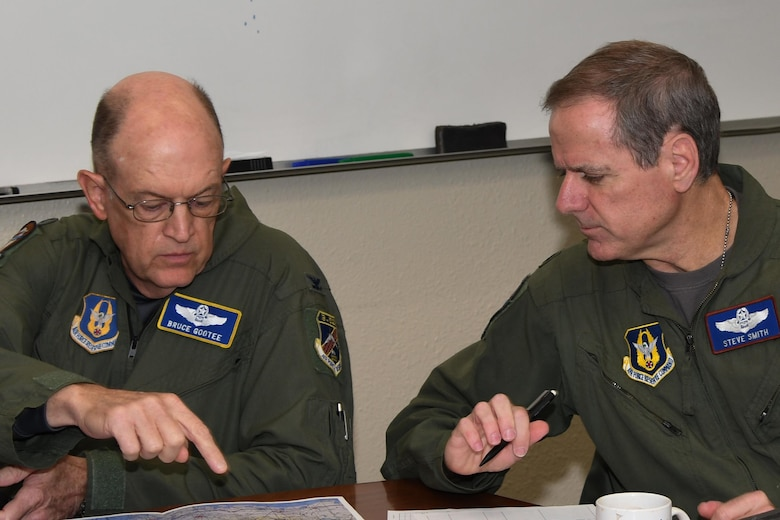 U.S. Air Force Col. Bruce Gootee, 307th Bomb Wing navigator and Lt. Col. Steve Smith, 93rd Bomb Squadron flight instructor, review a map during an early morning mission briefing at Barksdale Air Force Base, La., March 3, 2017.  The routine training mission took on great significance as it put Smith over 10,000 flight hours in the B-52 Stratofortress, a feat not accomplished in more than 30 years. (U.S. Air Force photo by Tech. Sgt. Ted Daigle/Released)