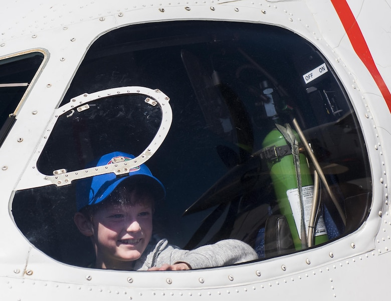 """A new 919th Special Operations Wing deployer checks out the view from the pilot seat of a C-145A Skytruck during the Operation Hero event at Duke Field, Fla., March 4.  The wing held a mock deployment for the Reserve children to include a deployment line, simulated flight and a """"down range"""" location with games and displays.  (U.S. Air Force photo/Samuel King Jr.)"""