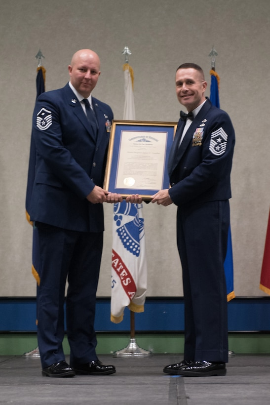Master Sgt. Aaron W. Vanallen, First Sergeant for the 123rd Maintenance Group, was recognized as the First Sergeant of the Year by Chief Master Sgt. Ray Dawson, the 123rd wing command chief, during the Soldier and Airman of the Year banquet at the Kentucky Fair and Exposition Center, Louisville, Ky. on March 4, 2017. VanAllen was selected for his leadership and performance in his primary duties, dedication to self-improvement, and base and community involvement. (U.S. Air National Guard photo by Staff Sgt. Joshua Horton)